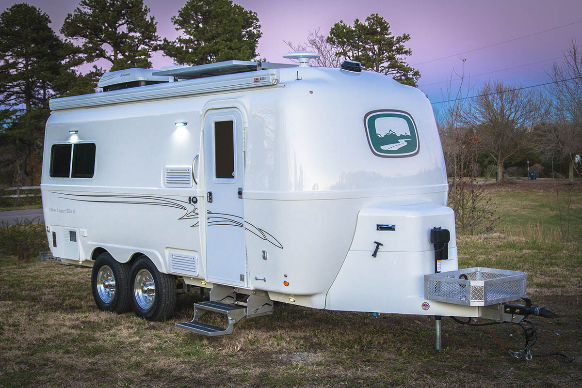 oliver travel trailers legacy elite 2 at evening with lights on