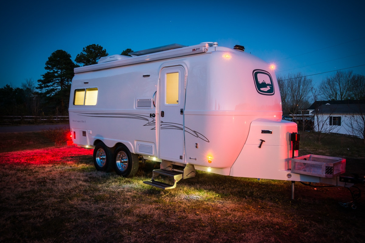 oliver travel trailers legacy elite 2 at night with lights on