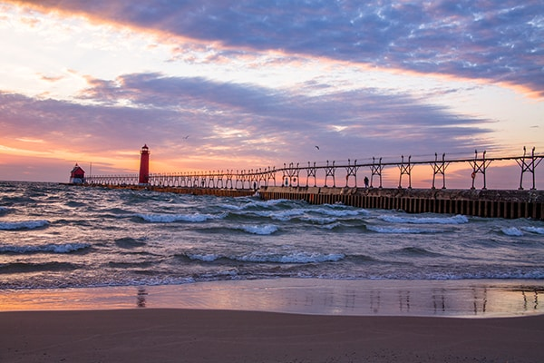 A Beautiful Sunset At The Grand Haven South Pierhead Lighthouse Michigan USA