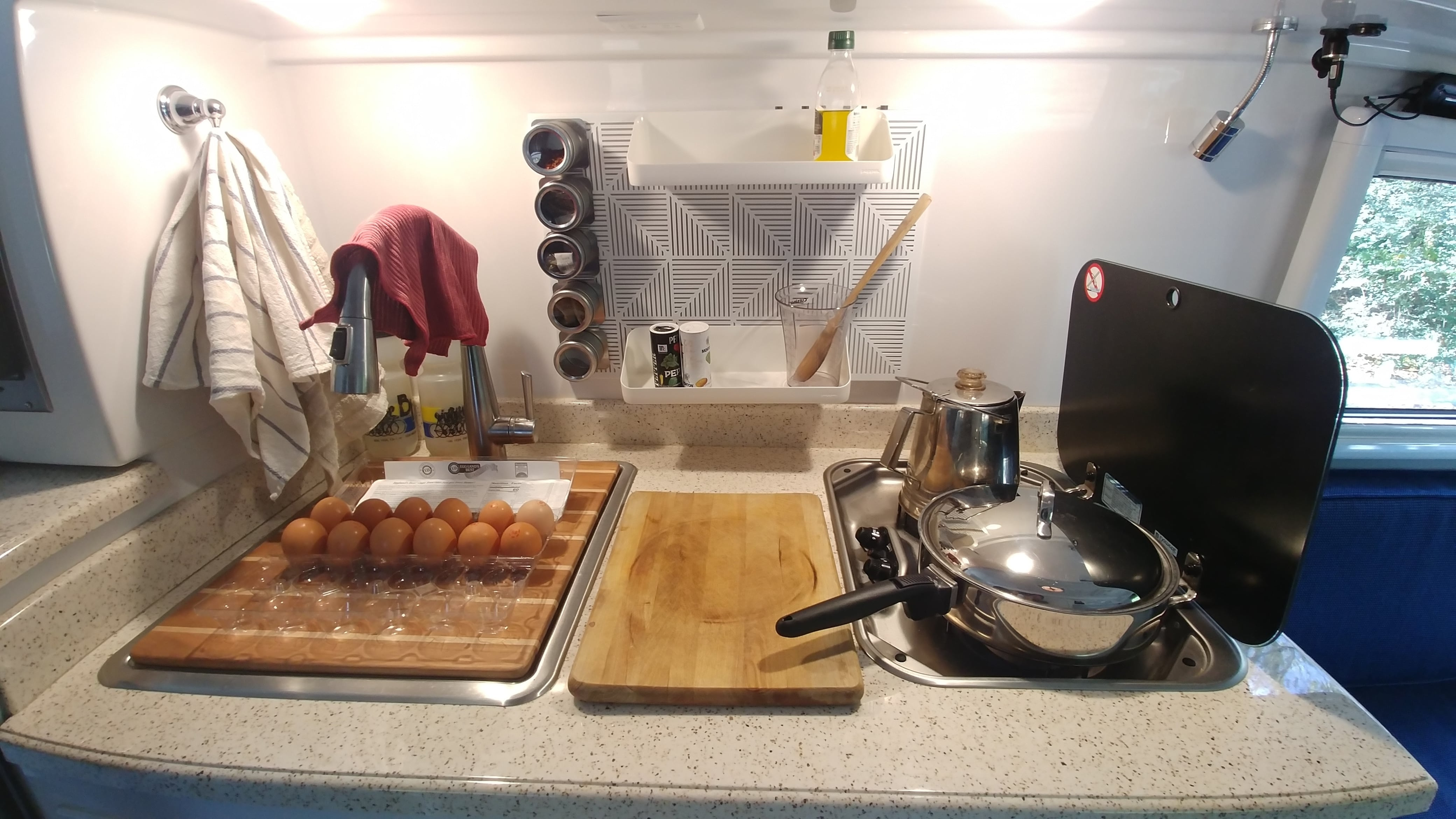 This is a magnet board mounted with heavy duty Velcro. The shelves really help extend the counter space when cooking. Also the sink cover/cutting board Foy Sperring makes are so worth the money!